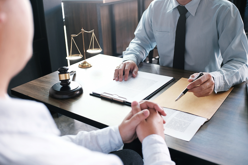 Solicitor dealing with paperwork with client