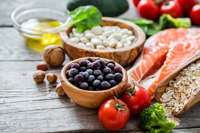 Selection of fish, fruits and vegetables to boost health.