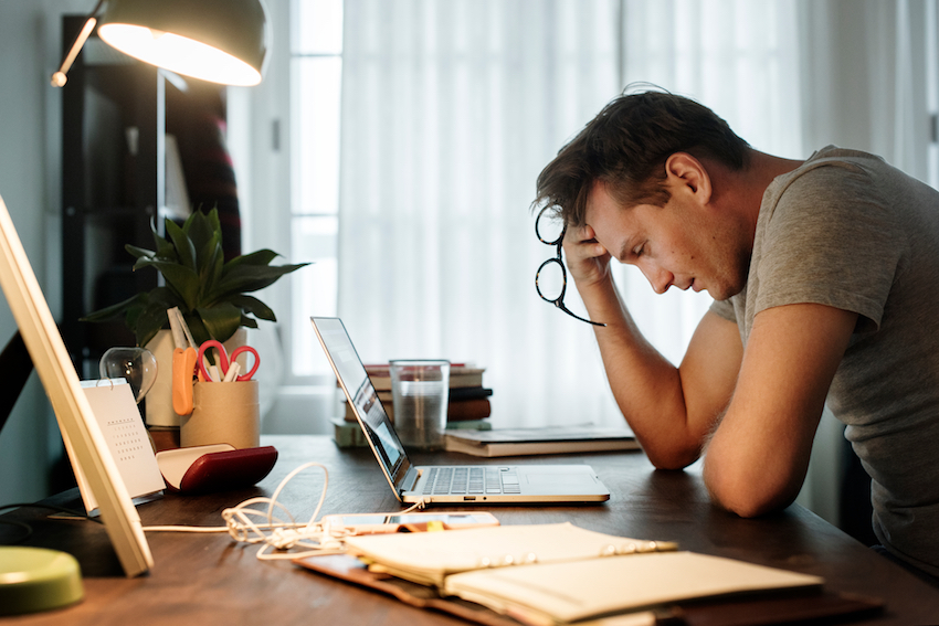 Man stressed at his work desk